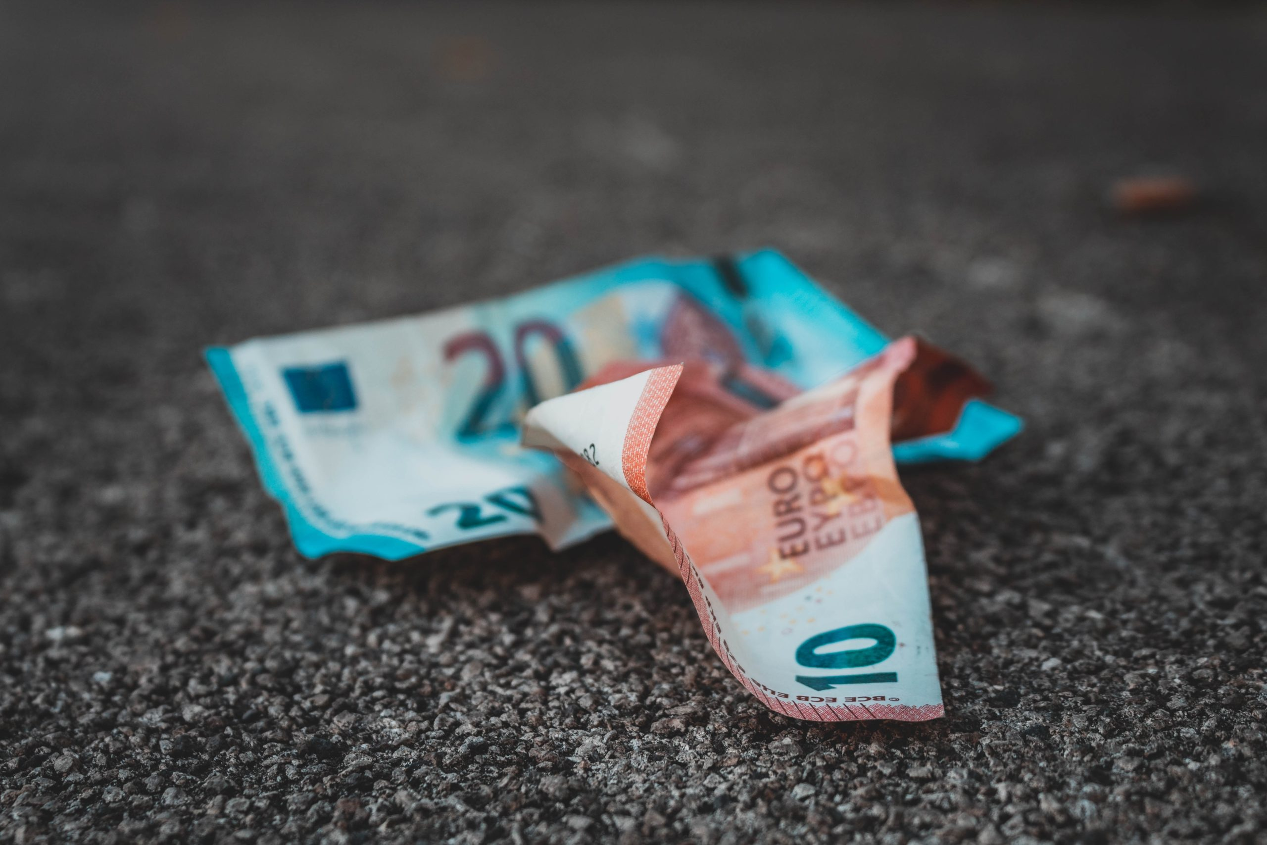 A pile of crumpled euros on the ground