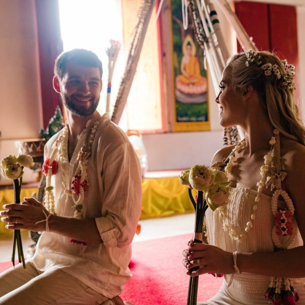 bride and groom in a thai temple