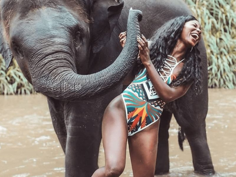 happy guest with a baby elephant
